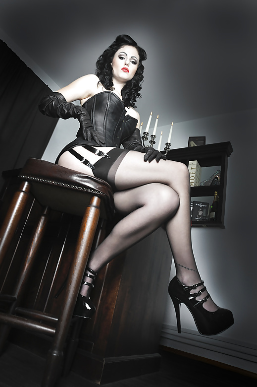 Stefani recommends Hogtied on table in latex corset